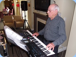 Laurie Conder playing his Roland BK-9 keyboard.