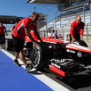 Marussia pit crew pushing F1 car