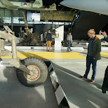 analysing the additional fuel tank of a tank at Dutch National Military Museum Soesterberg in Soest, Utrecht, Netherlands