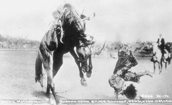 Bonnie McCaroll being thrown, Pendleton Rodeo