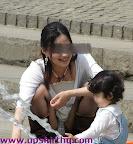 Mummy tending to daughter