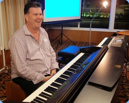 Our Special Guest Artist, Chris Larking, setting-up the Club's Yamaha Clavinova CVP-509. Photo courtesy of Dennis Lyons.