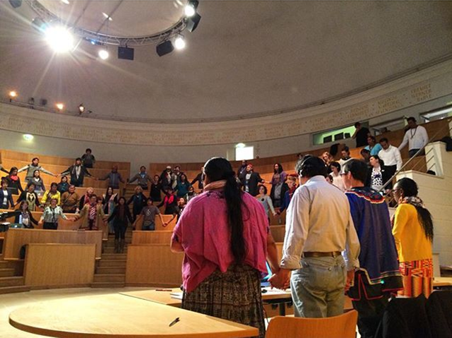 Solemn moment of solidarity on 29 November 2015 as global indigenous caucus at COP21 begins. Indigenous peoples from Asia, Europe, Latin America, North America, and Africa will tackle their proposal to #COP21. Indigenous caucus to #COP21: 'Our call comes from our lands, mountains, forests, rangelands, and seas that suffer droughts, floods, melting of glaciers, and thawing of permafrost and loss of sea ice.' Photo: Voltaire Tupaz / Instagram