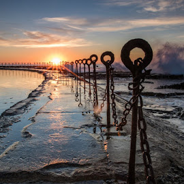 Old rock pool, Newcastle by Howard Ferrier - Buildings & Architecture Bridges & Suspended Structures ( merewether, post, splash, pacific ocean, swimming pool, sea, newcastle, sun, fence, dawn, pole, chain, pool, contre jour, sunrise, puddle, rust, wall )