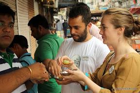 eating gol gappas in Delhi http://indiafoodtour.com  http://foodtourindelhi.com