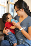 LePort Private School Irvine - Montessori teacher feeding baby at Irvine daycare