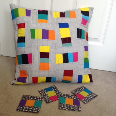 Colour Block improv cushion and coasters featured in Issue 14 of Quilt Now