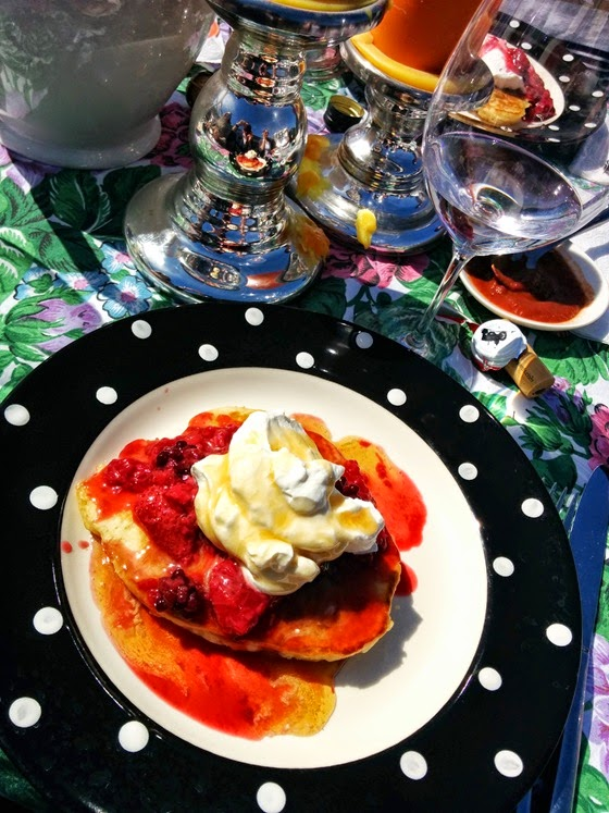 Homemade pancakes, triple-berry compote, whipped cream, and heavenly maple syrup