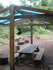 Royce-Finel has sparse amenities in a few campsites. There are a few tarp shelters (bring your own tarp), picnic tables, and fire rings.