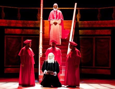 IN PERFORMANCE: (left to right) Jacob Kato, Wesley McCleary-Small, and Matthew Reese as the Cardinals, Deon'te Goodman as Pope Urban VIII (rear), and Derek Jackenheimer as Old Galileo (front) in Philip Glass's GALILEO GALILEI at UNCG Opera Theatre, April 2015 [Photo by Amy Holroyd, © by UNCG Opera Theatre]