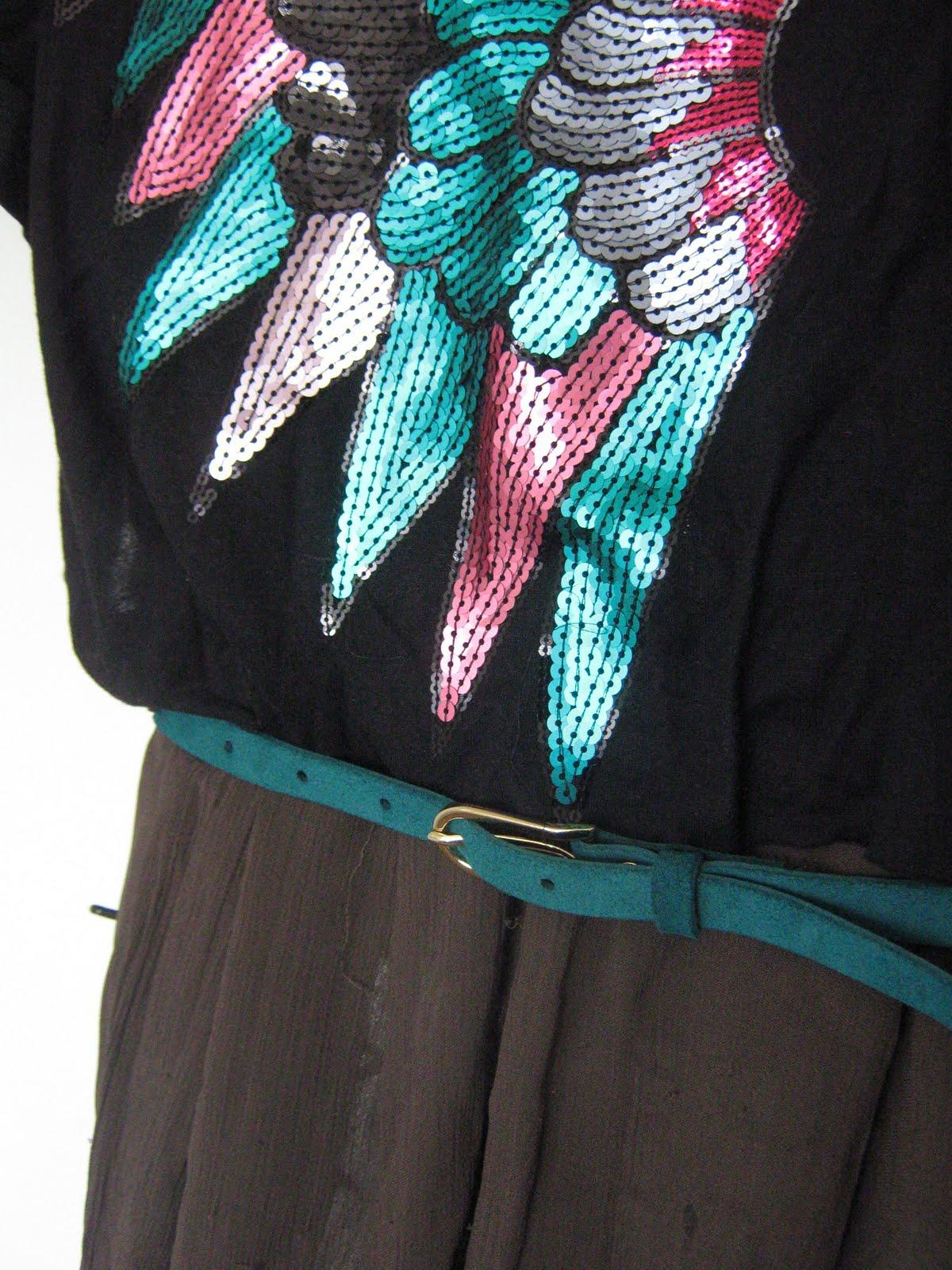 Detail of the peacock shirt