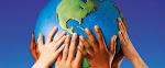 Children's Hands on a Globe --- Image by © Don Hammond/Design Pics/Corbis