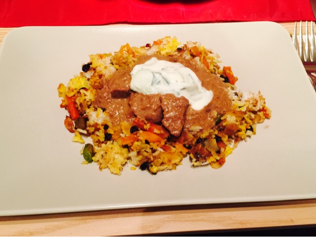 Iranian barberry and pistachio rice with Lamb stew and yoghurt dressing