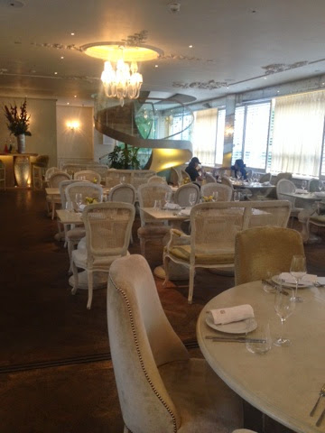 White regal seating inside Baku restaurant in London