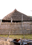 Restored historical house with thatched roof.