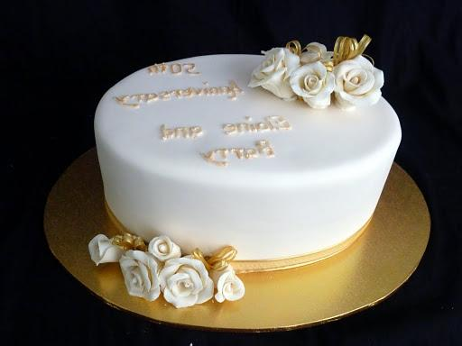 50th Wedding Anniversary cake. 2 cakes high with hand made roses.