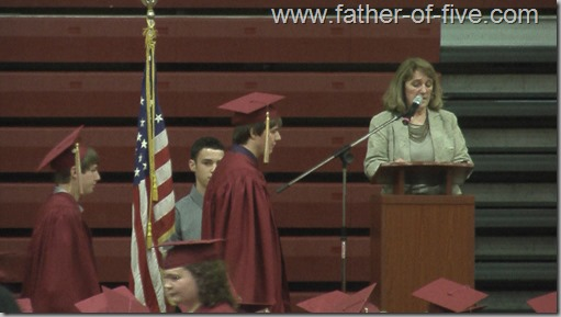 #3 of 5 walking the stage to get his diploma.