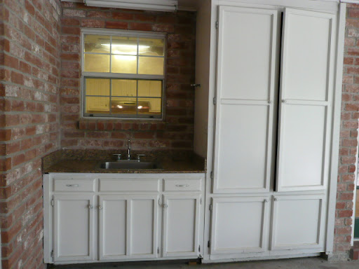 Outdoor sink w/ granite countertop.  Large storage cabinets.