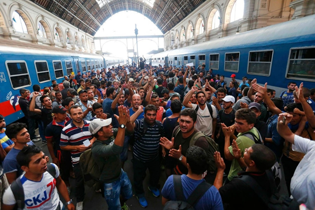 Refugees mass in the Keleti train station in Budapest, Hungary, on 4 September 2015. Approximately 1,000 people were forced to leave the building, despite holding tickets for transport to Germany. Photo: Laszlo Balogh / Reuters