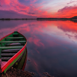 Colourfull sunset by Justinas Kondrotas - Landscapes Waterscapes ( clouds, sunset, lake, boat, colours )