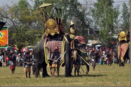Elephant at Surin Elephant Festival, Thailand; note the foot guards stationed at the elephant's legs