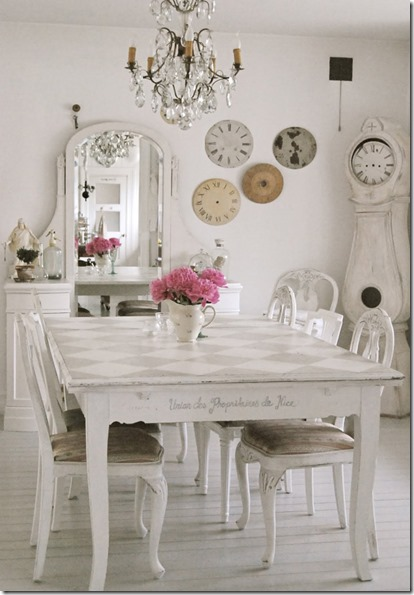 shabby-dining-room-furniture-white-cloth-board-white-chairs-brown-cushions-pink-flowers-in-white-jar-cream-white-brown-grey-clocks-on-white-wall-white-m
