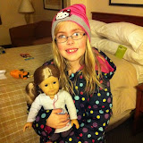 Hannah and her new American Girl doll in our hotel room in Chicago 01142012