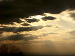 Sun bursting through the clouds, Washington Monument State Park in Boonsboro, Maryland.