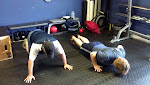 Kyle and Christopher taking on burpees.