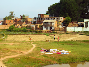 A photo of Tana (the capital city) taken out the window of our taxi. Some kids are playing in front of their still-empty fields, while their family's clothes are drying on the ground.