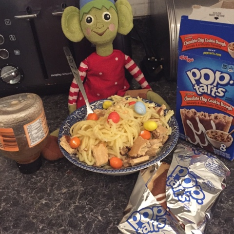 elf on the shelf making candy spaghetti