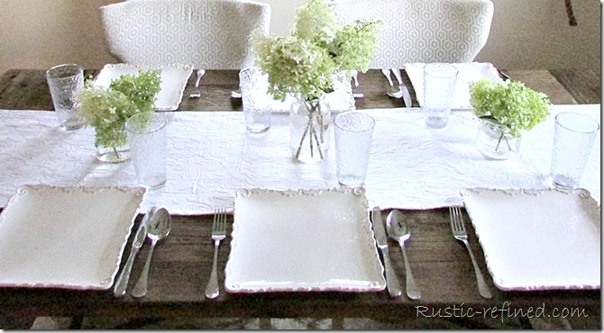 Farmhouse Tablescape Idea using a simple flower arrangement and white dishes