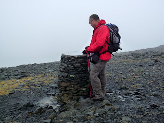 David looks at the topograph although I don't think he could pick anything out beyond the cloud filled summit.