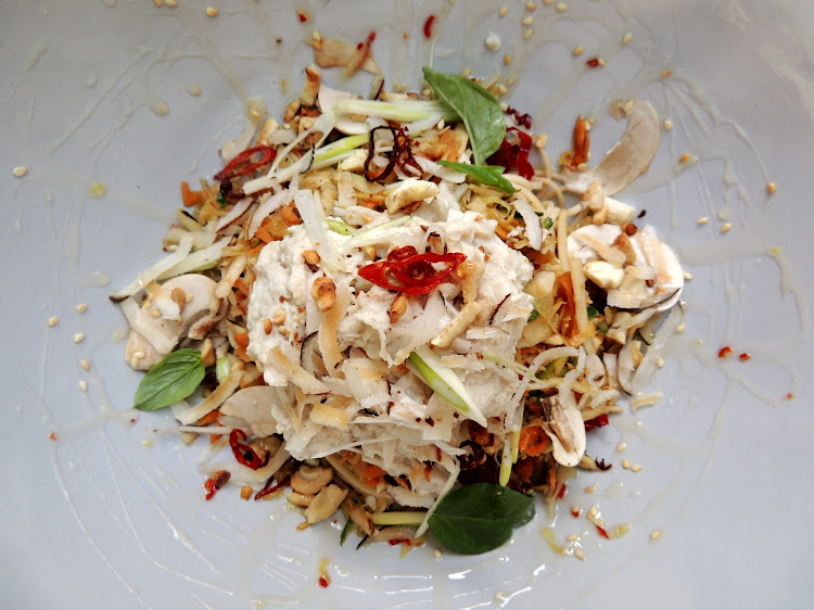 Poached lemongrass and coconut chicken on satay noodle salad with Thai basil and crispy chilli