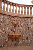 "2"" x 4"" Rock face wall tile on 12"" mesh backing Scabos travertine."