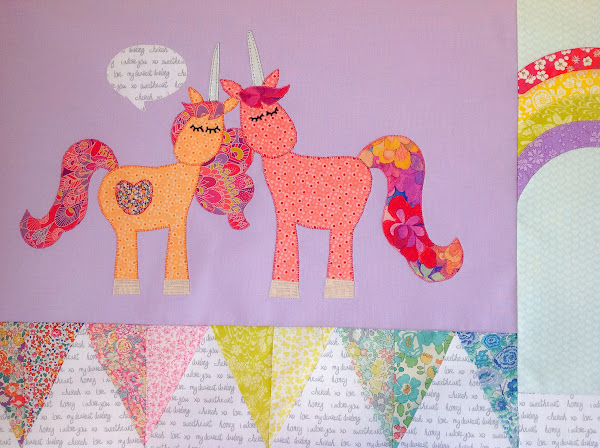 Two unicorns talking quilt applique block
