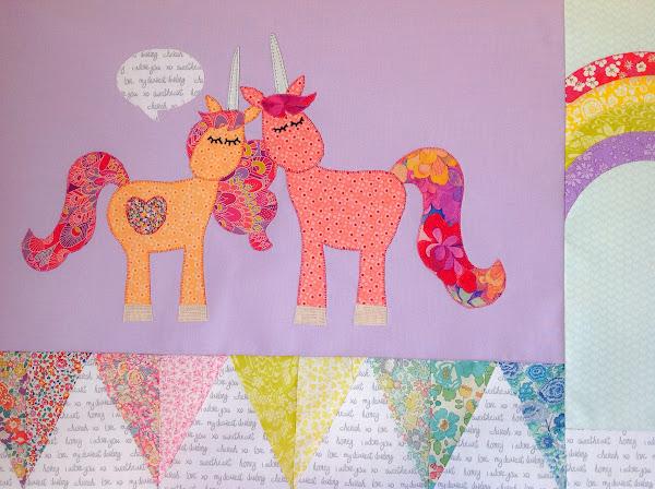 Two unicorns talking quilt applique block