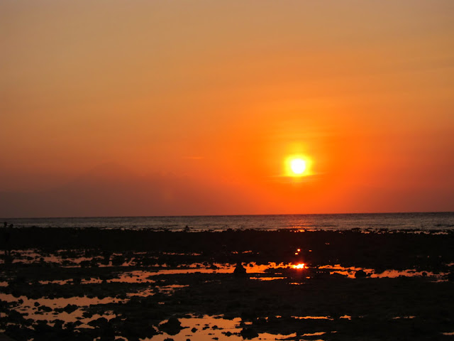 Sunset on Gili T. You can see the outline of Bali's Mount Agung Volcano at left.