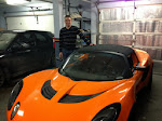 Eric and his Lotus in their huge 3-car garage
