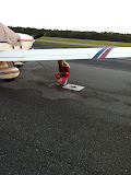 Untying the plane for our trip home from Destin FL 03242012a