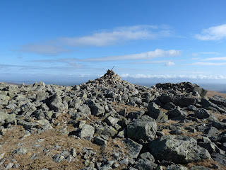High Raise Summit. Wainwright No. 3. The summit is strewn with rocks.