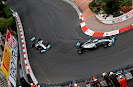 Nico Rosberg and Lewis Hamilton racing their Mercedes W05