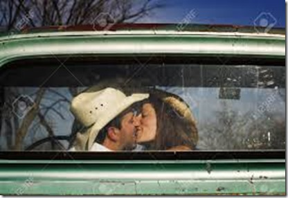 4404633-Cowboy-and-girlfriend-kissing-in-through-the-back-window-of-a-pickup-truck-Stock-Photo