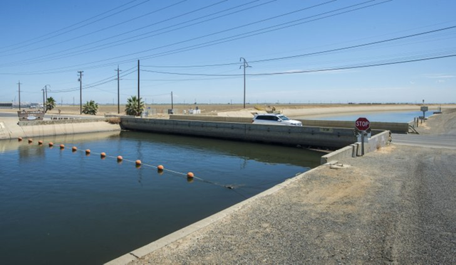 The drought has caused The Russell Avenue Bridge in Firebaugh, California, to subside until there's almost no space between bottom of bridge decking and canal water surface. A NASA scientist says in a report released Wednesday that parts of California's Central Valley are sinking faster than ever as groundwater is being pumped during the state's historic drought. Photo: Florence Low / AP