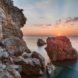 First rays by Olga Parshina - Landscapes Sunsets & Sunrises ( water, clouds, ray, sky, gulf, stone, sea, seascape, turkey, sunrise, motion, sun,  )