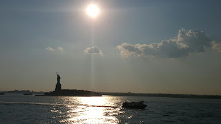I waved to Miss Liberty (along with throngs of tourists angling to get a picture)