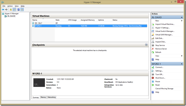 Hyper-V Manager with VM showing Moving Storage status