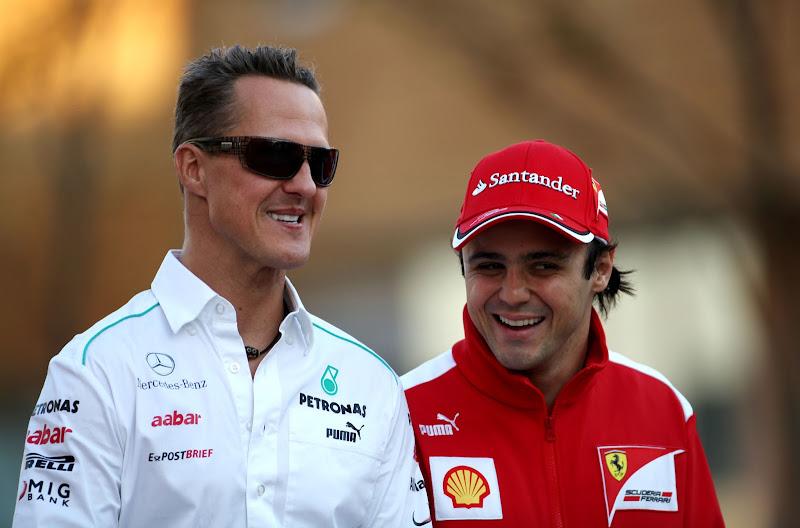 улыбающиеся Михаэль Шумахер и Фелипе Масса на Гран-при Кореи 2012