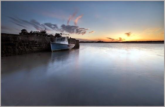 fishing-boat-docked-at-sunset-326737