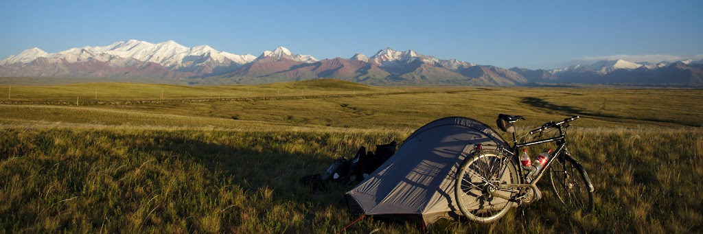 The last camping spot in Kyrgystan, before the Pamir. The 7000 meter high mountain range rises like a barrier in from of anyone comming from the north. In the middle the gate to the Pamir's the Kyzyl-Art pass is visible.